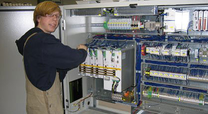Member of staff assembling a switch cabinet